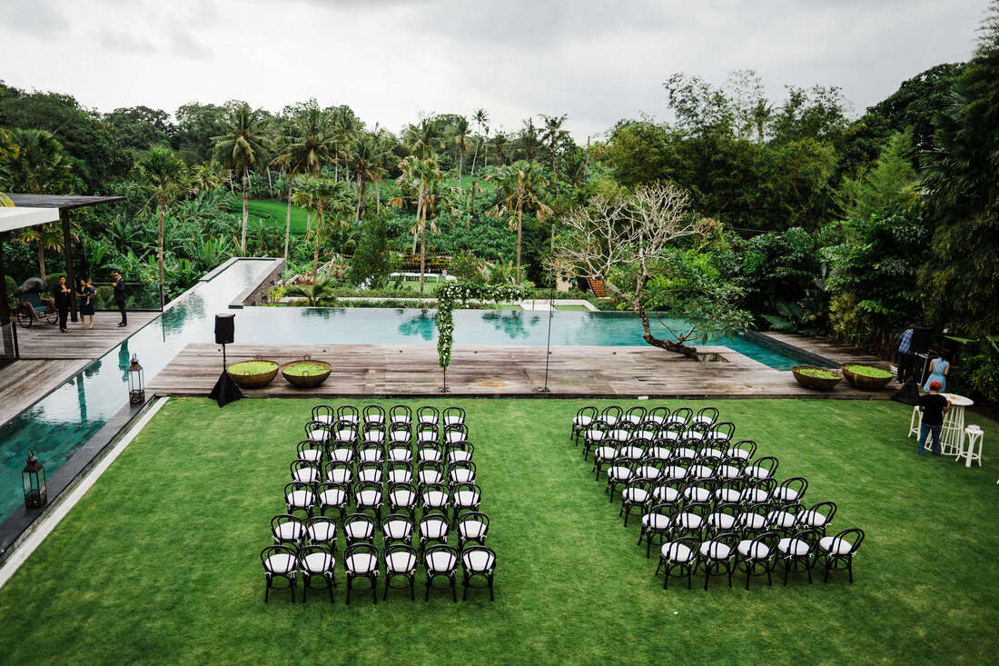Modern wedding ceremony setup in a private villa in Bali with tropical backdrop