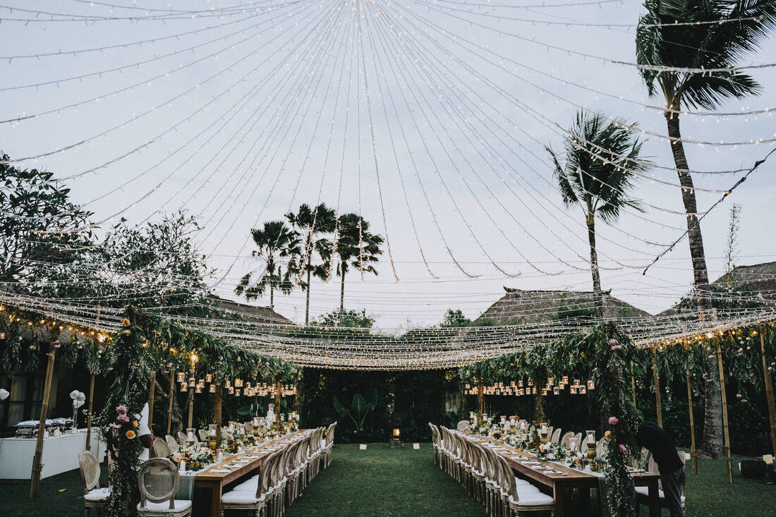 Wedding reception setup with fairy lights tent